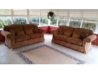 2 matching 3-seater fabric sofas.