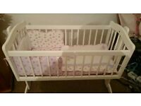 BabiesRus swinging crib immaculate condition with cot bumper set and waterproofmattress. Hardly used