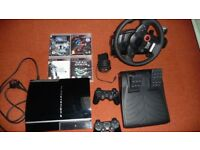 PS3 + steering wheel + 4 Games