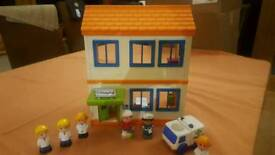 ELC Happyland Hospital with car and people
