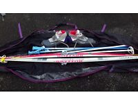 Blizard Firebird cross country skis, poles and boots in carry case.