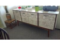 Sideboard vintage with three compartments,drawers. Wooden interior.