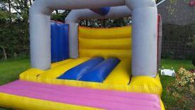 Bouncy Castle large with bubbles machine.
