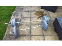 Two bars with 50kg worth of weights