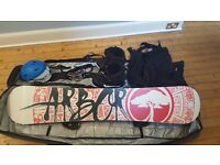 Complete snowboard package. Board, boots, bindings, bag, helmet, goggles, sallopettes.