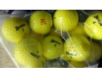 12 yellow soft feel and 3 yellow trispeed golf balls