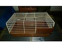 Brand new indoor red cage easy access and hay feeder .