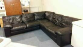 Very large black leather corner sofa. Vgc. Delivery possible
