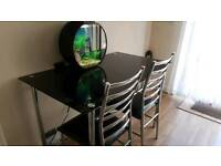 Glass dining table and matching tv unit