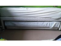 Single bed with pull out guest bed stored underneath