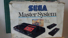 Boxed Sega Master System with light gun and 16 games (Rare collectable)
