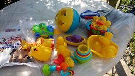selection of baby toys and equipment