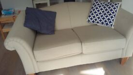 Beige 2 seater sofa by Laura Ashley