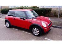 Red Mini Cooper, 3 door, with long MOT