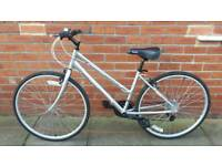 Ladies Reebok Hybrid bike EXCELLENT CONDITION ONLY USED ONCE. 17 inch light weight frame. 21 speed.