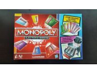 Monopoly Electronic Banking. Box is open but game never been used. All in original sealed packaging