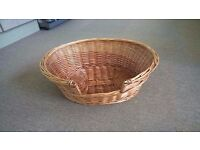 wicker dog/cat basket Medium Approx 23 inches long and 18 inches wide not used