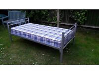 Metal single bed with good mattress and removeable side toddler guard