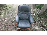 Dark green captains chair and footstool