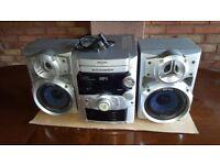 Panasonic SA-AK220 stereo system. 5 CD changer, tape & radio.