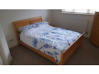Wooden frame double bed.