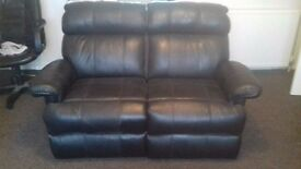 Black Leather Sofas - Three-seater (Fold out double bed) & two-seater recliner