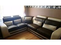 Leather corner sofa....Brown and cream color