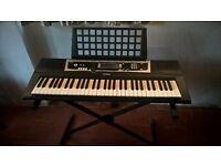 Yamaha YPT-210 keyboard and stand