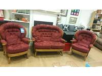 Three piece suite burgundy with wood frame. Fabric in excellent conditon
