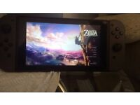Nintendo switch plus Zelda special edition with statue