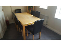 IKEA SOLID WOOD EXTENDING TABLE & SIX UPHOLSTERED CHAIRS. Light oak in colour.