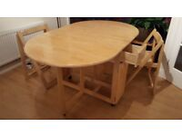 Dining table with folding ends plus 4 folding chairs