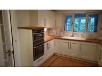 Kitchen Units - Cream shaker style kitchen units with solid oak work tops