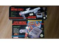 Boxed super nintendo and scope with 9 games