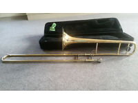 Trombone. Bb student trombone, with case and music stand.