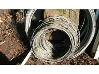 Large quantity of coiled fencing wire.