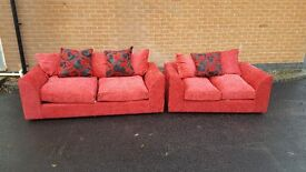 Really nice Brand New bright red pink sofa suite. 3+2 seater sofas, tiny mark, can deliver