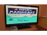 Super Nintendo, 2 controllers and 8 games