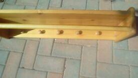 Pine wood shelf with rail and hooks
