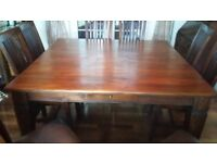 5 ft square oak dining table and 8 beautiful brown leather upholstered chairs