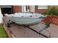 Aluminium boat on trailer.
