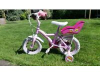 Cupcake bike with stabilisers, bell and baby carrier - very good condition
