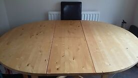 Dining table (extendable to 6) and 4 chairs