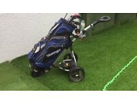 Power Bug electric golf trolley with a handful of men's clubs