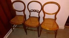 Three wickerwork chairs