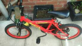 Apolo childs bike on stabilisers an