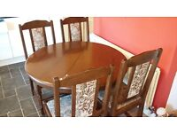 Extending dining table 4 chairs