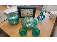 Collection of teal blue ornaments and clock