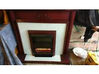 Mahogany effect fire surround with electric fire