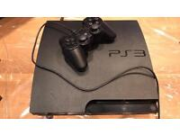 PS3 console, two games and accessories